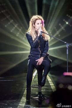 Coco Lee in Saint Laurent Metallic Trimmed Wool Coat