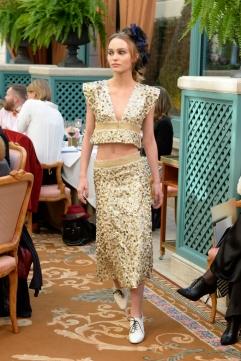 Lily-Rose Depp walks the Chanel Métiers d'Art show at the Ritz