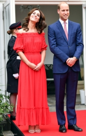 Britain's Prince William and Catherine, Duchess of Cambridge speak with German Football Association (DFB) secretary general Friedrich Curtius at the 'Queen's Birthday Garten Party' in British ambassador's residence in Berlin