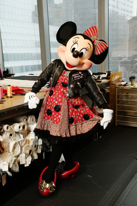 Minnie Mouse is fitted by Stuart Fevers for her custom Coach outfit.