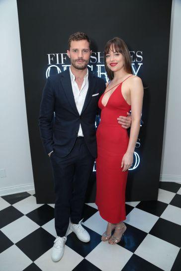 Dakota Johnson in Cushnie et Ochs Fall 2017 with Jamie Dornan in Hermes-1