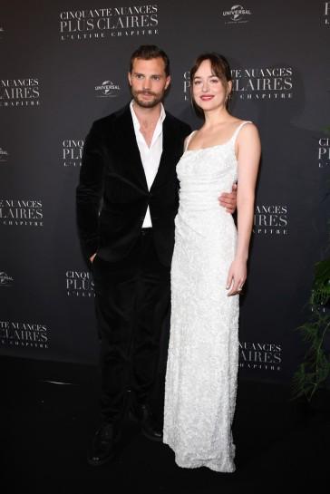 Dakota Johnson in Prada & Jamie Dornan in Tod's