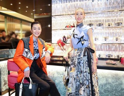 Liu Wen in Prada Spring 2018 with Shupei Qin in Prada Spring 2018-2