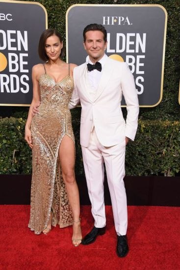 irina shayk in atelier versace and bradley cooper in gucci