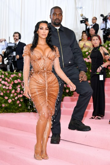 Kim Kardashian in Mugler and Kanye West in Dickies
