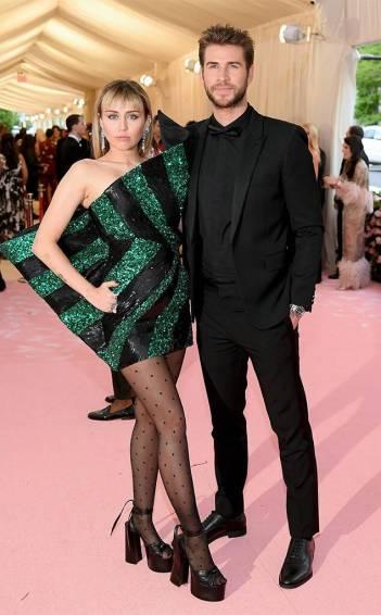 Miley Cyrusin Saint Laurent with Liam Hemsworth